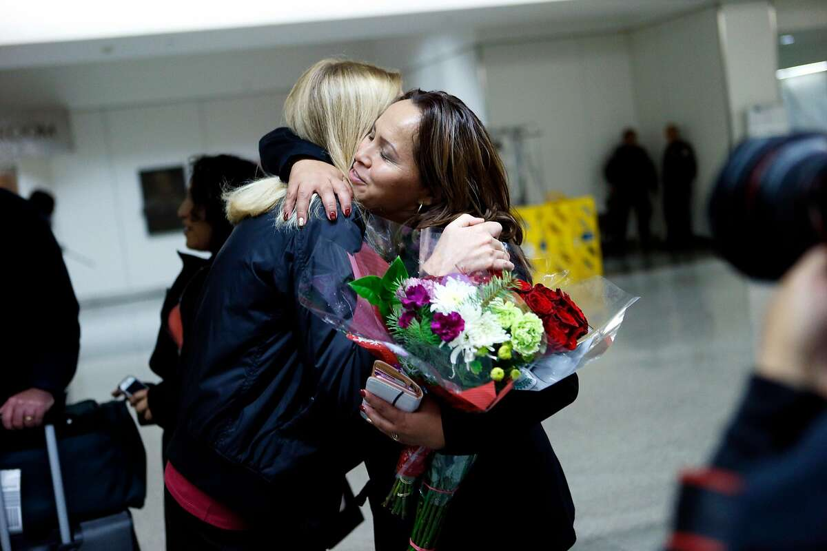 Maria Mendoza-Sanchez is greeted by friends and family at SFO on Saturday, Dec. 15, 2018, in San Francisco, Calif. Mendoza-Sanchez, a nurse who was separated from her children and deported to Mexico last year after more than two decades in Oakland, won her improbable fight to return to the United States. Her visa was approved by U.S. Citizenship and Immigration Services.