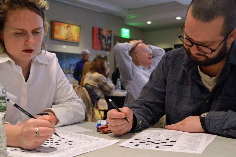 Emily Weber and Jack Donovan of New York City get in some practice at The Westport Library's 20th Annual Crossword Puzzle Contest at Saugatuck Congregational Church, Saturday, Feb. 2, 2019, in Westport, Conn. Photo: Jarret Liotta / For Hearst Connecticut Media / Westport News Freelance