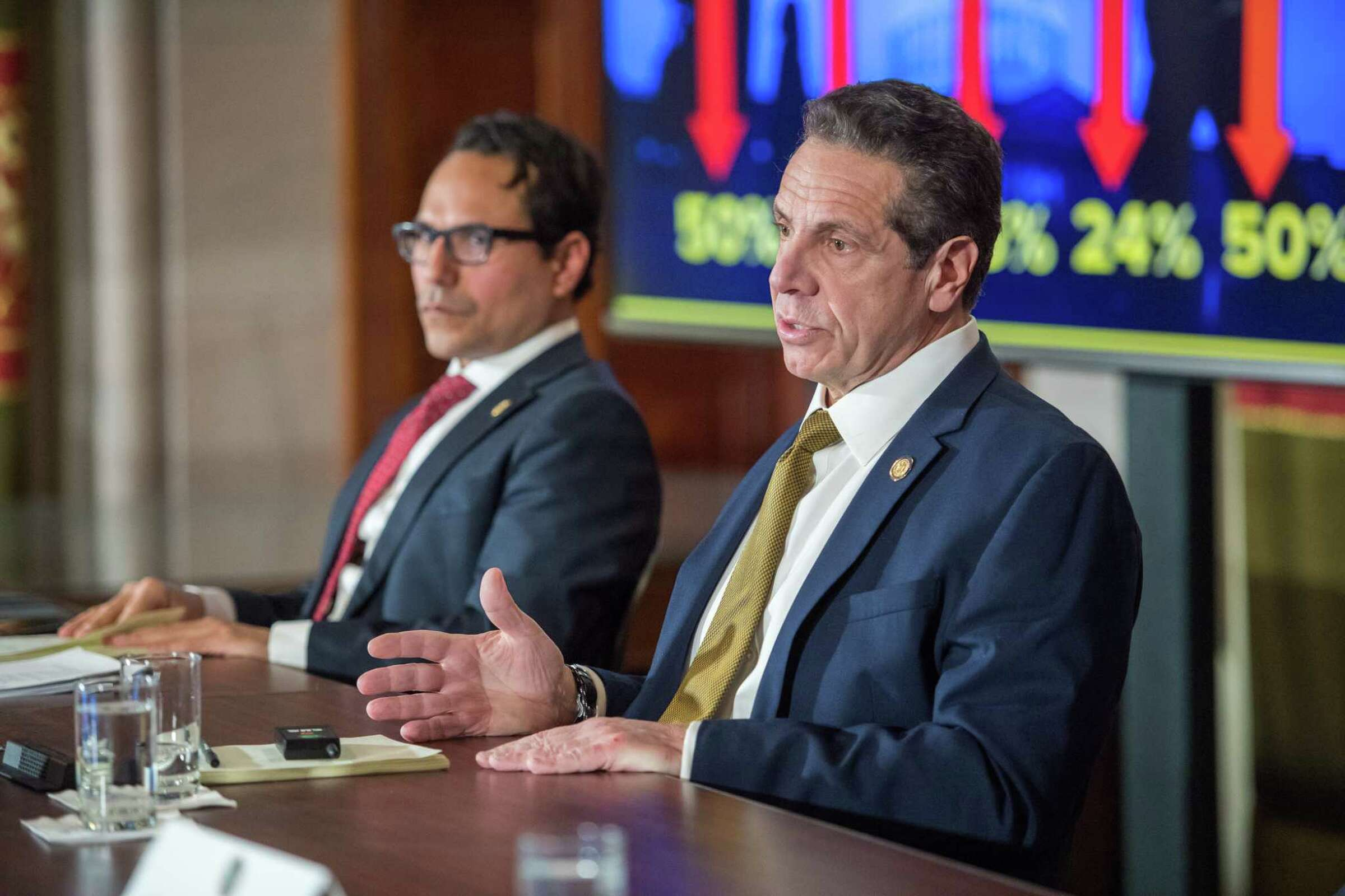 governor cuomo at table speaking