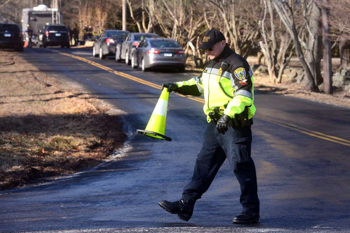 The scene looking down Catamount Road in Fairfield on Monday. James Taylor, 75, of Fairfield, is accused of shooting his ex-wife, Catherine, 70, to death inside her home on Catamount Road on Sunday evening.