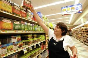 Jessica Papagrannopoulos stocks shelves at the Big Y Supermarket in New Milford Thursday, May 10, 2012.