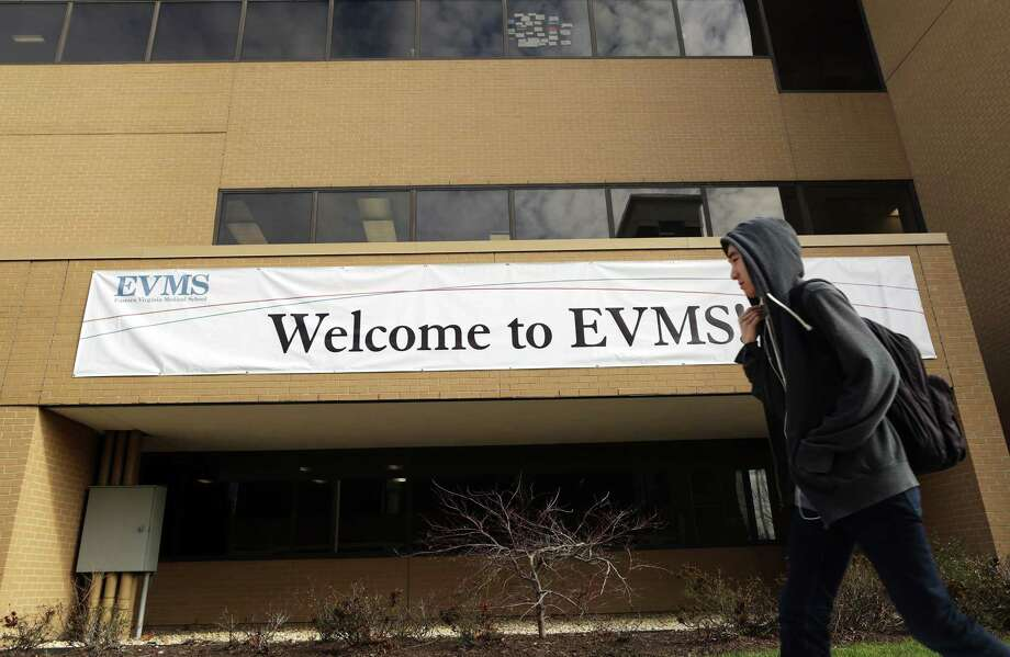 A pedestrian walks past a banner welcoming students and visitors to Eastern Virginia Medical School in Norfolk, Va., on Feb. 4. Photo: Photo For The Washington Post By Vicki Cronis-Nohe / Vicki Cronis-Nohe