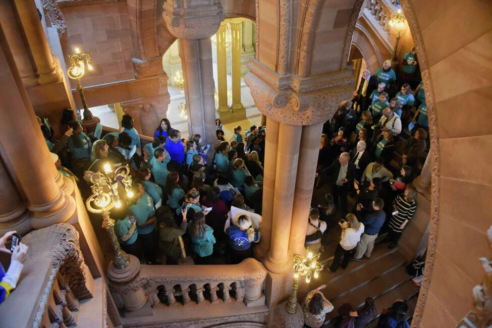 People gather on the Million Dollar Staircase at the Capitol to call for more funding for New York?•s child care system on Monday, Feb. 4, 2019, in Albany, N.Y. (Paul Buckowski/Times Union)