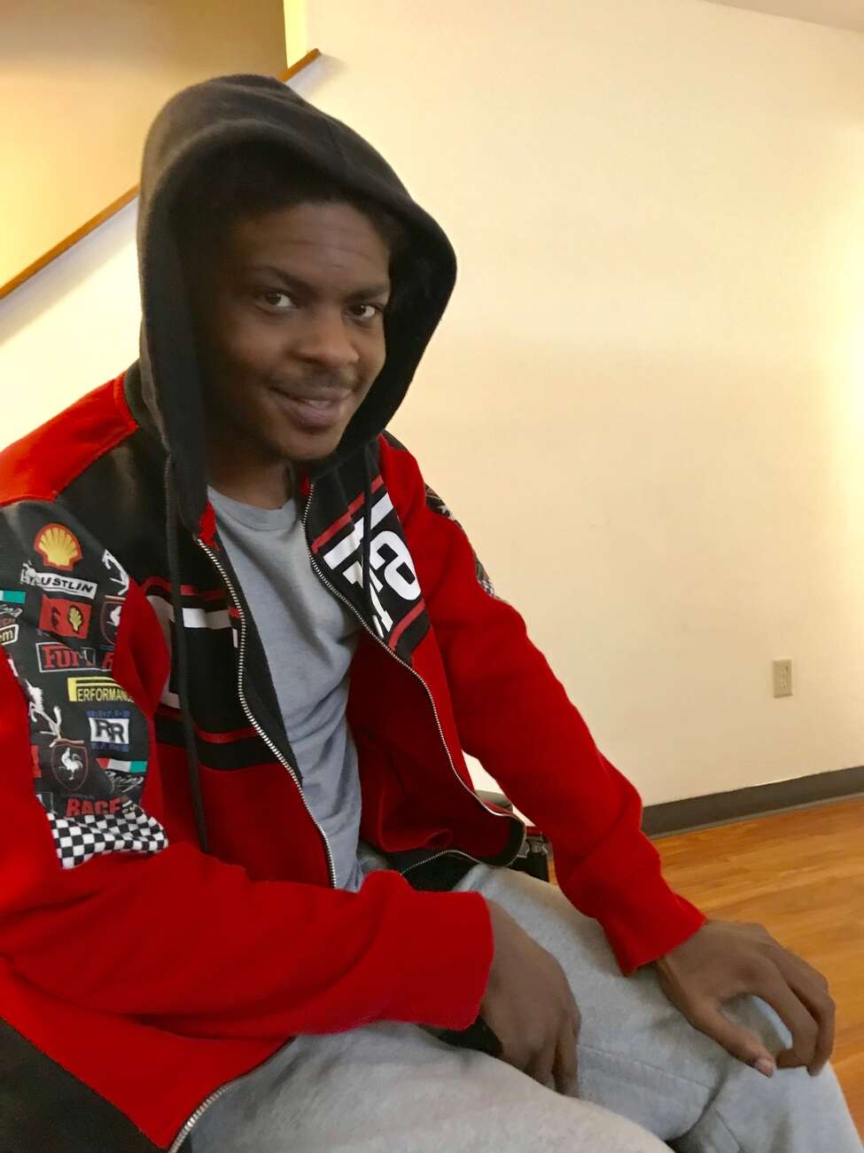 Ellazar Williams, shot by police in August and paralyzed as a result of the incident, is shown in his North Albany apartment on Jan. 27, 2019. He is using a wheelchair more regularly now and moved to a ground-level apartment so he can go outside. He insisted on wearing a hoodie over his head because he said he was having a bad hair day and his hair was not neatly braided. (Paul Grondahl/Times Union)