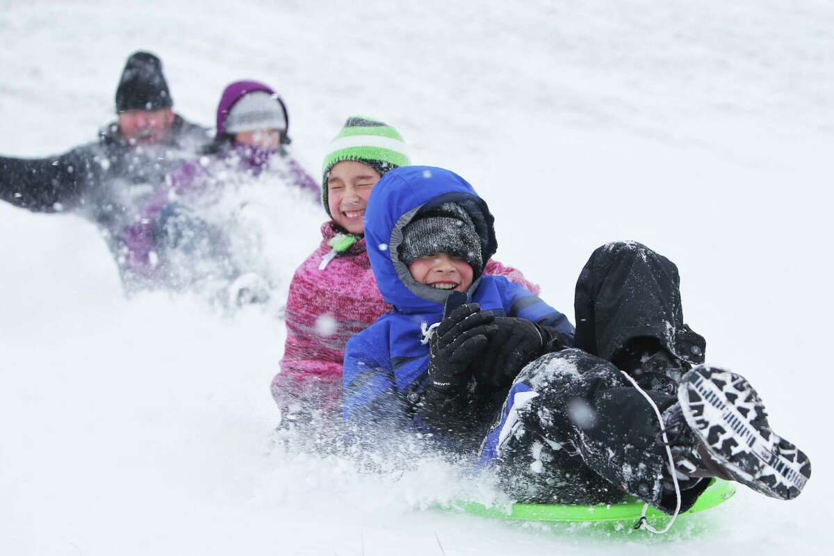 Kids and parents enjoy a snow day, sledding at Westcrest Park in White Center, Monday, Feb. 4, 2019. Seattle Public Schools were closed for the day due to several inches of snow that fell overnight and through the morning.