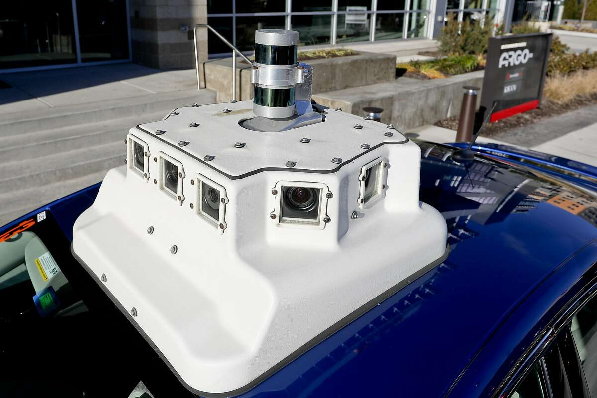 In this Dec. 18, 2018, photo a sensor and camera array on top of one of the test vehicles from Argo AI, Ford's autonomous vehicle unit, is parked at the company offices in Pittsburgh. Even the most optimistic experts say it will be 10 years before self-driving vehicles are everywhere, but others believe it will take decades. The biggest reasons are camera and laser sensors that can't see through heavy snow or figure out where to go if lane lines are covered. (AP Photo/Keith Srakocic)