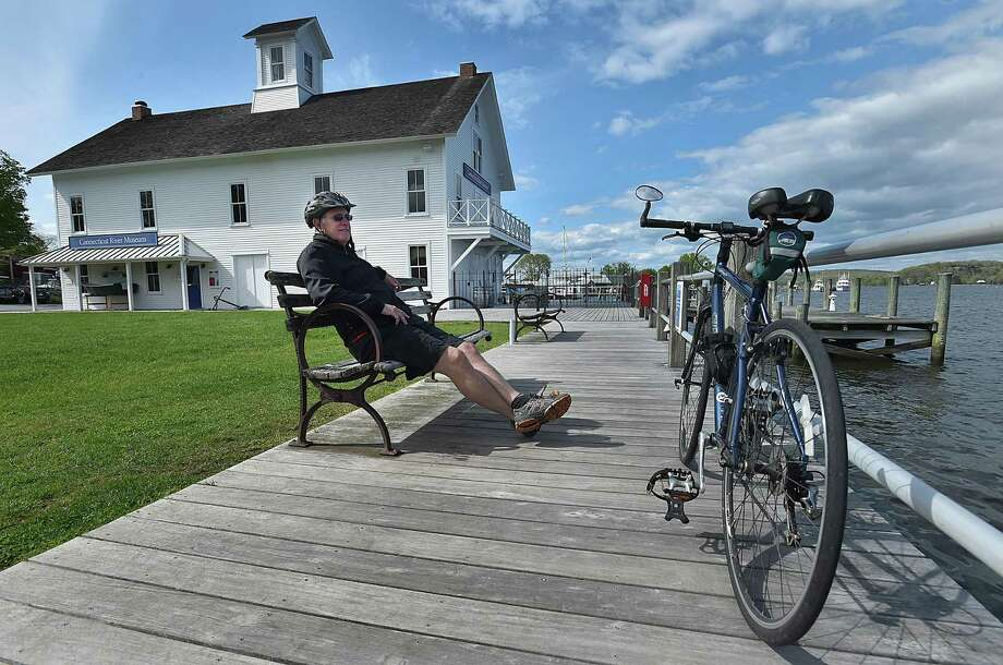 Essex resident Larry Freundlich takes a break from a 12-mile bike ride to enjoy the picturesque view of the Connecticut River at the Connecticut River Museum in Essex, Thursday, May 11, 2017. Photo: Catherine Avalone / File Photo / Catherine Avalone/New Haven Register