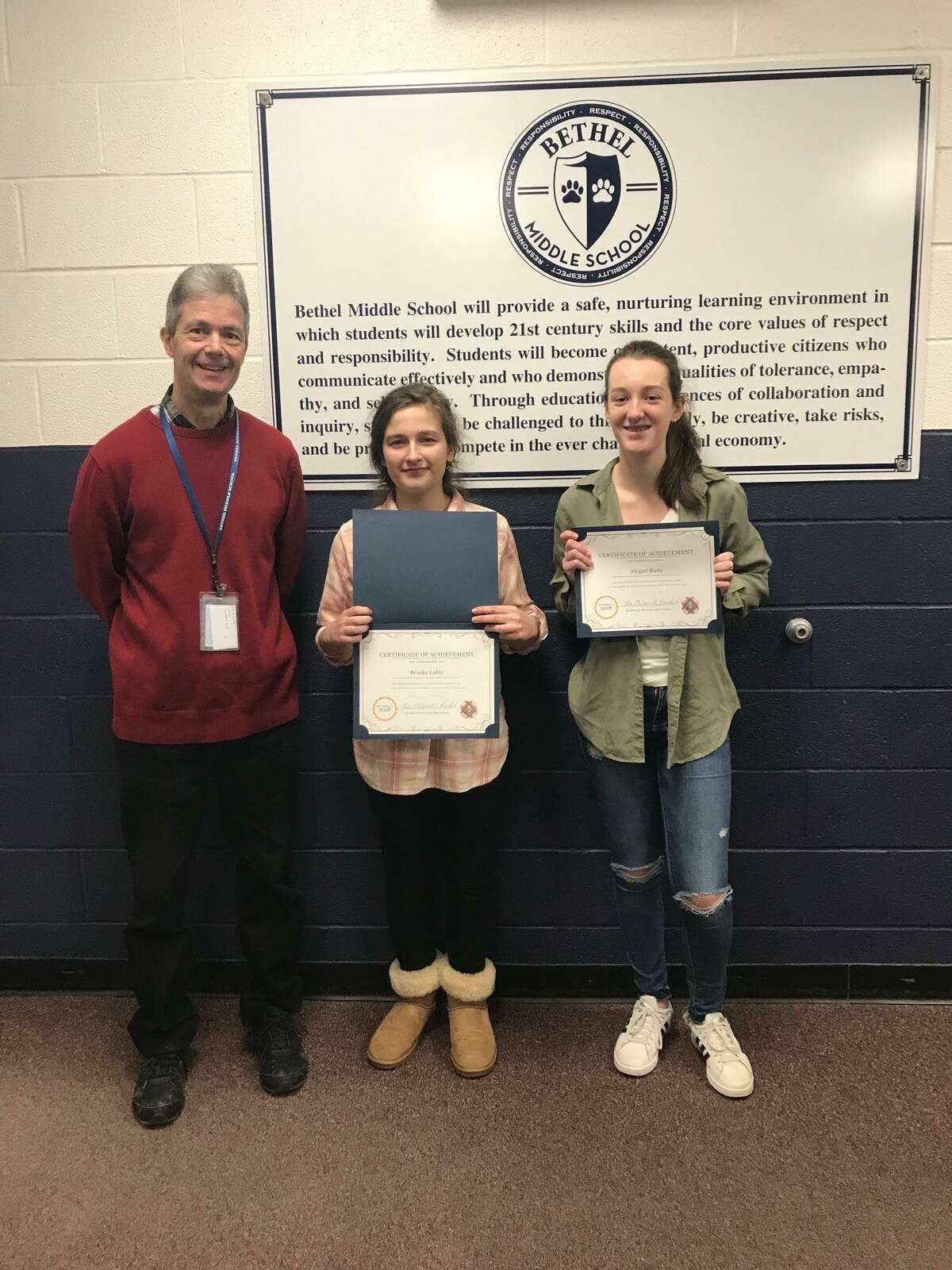Bethel Middle School students Abigail Riolo, right, and Brooke Lohle, center, with their teacher, Tom Salvador, left. Riolo earned first place and Lohle earned second place at the local level of the Bethel VFW Post 935 and the District 1 level for the Patriot's Pen essay contest. Riolo went on to earn an honorable mention at the state level.