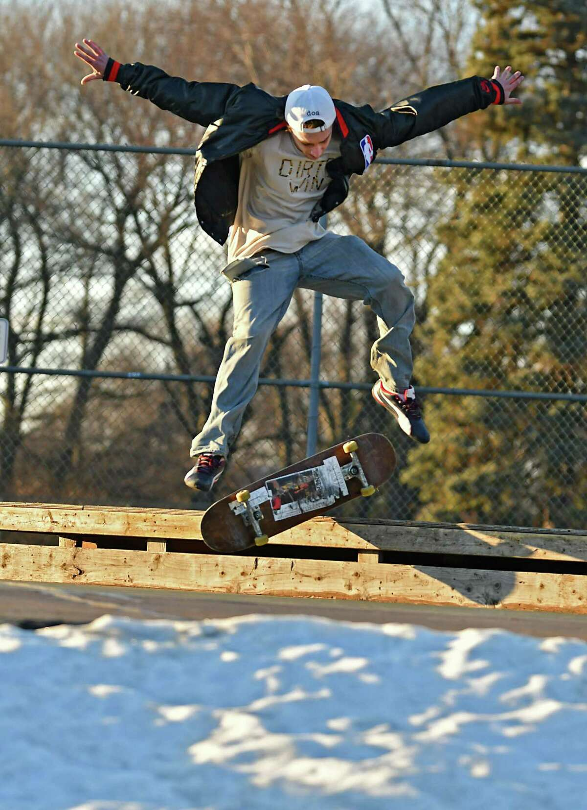 With snow still on parts of the skate park Andrew Grabowski of Albany finds a way to catch air on his skateboard in Washington Park during warm temperatures on Monday, Feb. 4, 2019 in Albany, N.Y. (Lori Van Buren/Times Union)