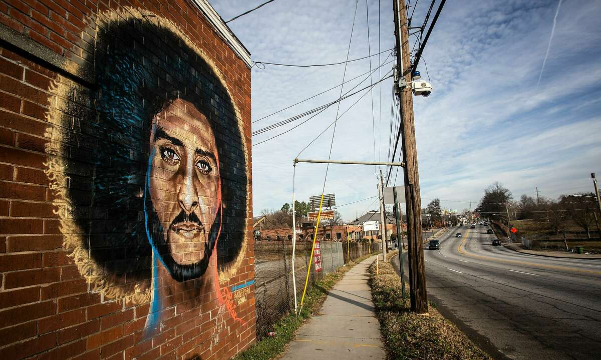 A mural depicting embattled NFL quarterback Colin Kaepernick is seen on a wall on Monday, Feb. 4, 2019, in Atlanta. Several such murals were hastily painted over the weekend across the Super Bowl host town in protest after one that had stood for two years was abruptly demolished on the eve of the big game. (AP Photo/ Ron Harris)