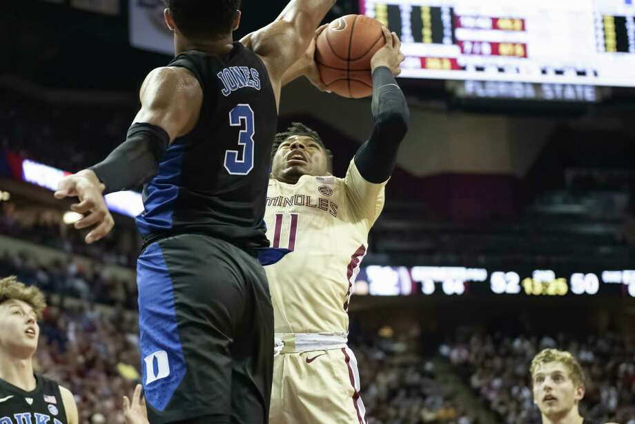 Former University at Albany player David Nichols (11), now playing for Florida State, goes up for a shot against Duke's Tre Jones on Saturday, Jan. 12, 2019. (Mike Olivella/Florida State athletics) Photo: MIGUEL OLIVELLA / ALL RIGHTS RESERVED