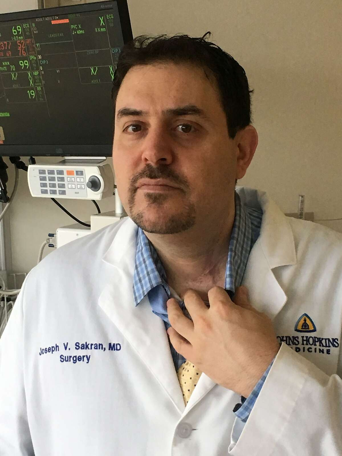 Dr. Joseph Sakran, a trauma surgeon who is taking aim at gun violence, shows scarring from the operation that saved his life, after he was shot in the throat in 1994, at Johns Hopkins Hospital in Baltimore, Maryland on January 2, 2018. - Now a trauma surgeon who fights to save shooting victims on the operating table, Sakran says gun violence in America is a health crisis that medical professionals can and should help address. (Photo by W.G. Dunlop / AFP)W.G. DUNLOP/AFP/Getty Images