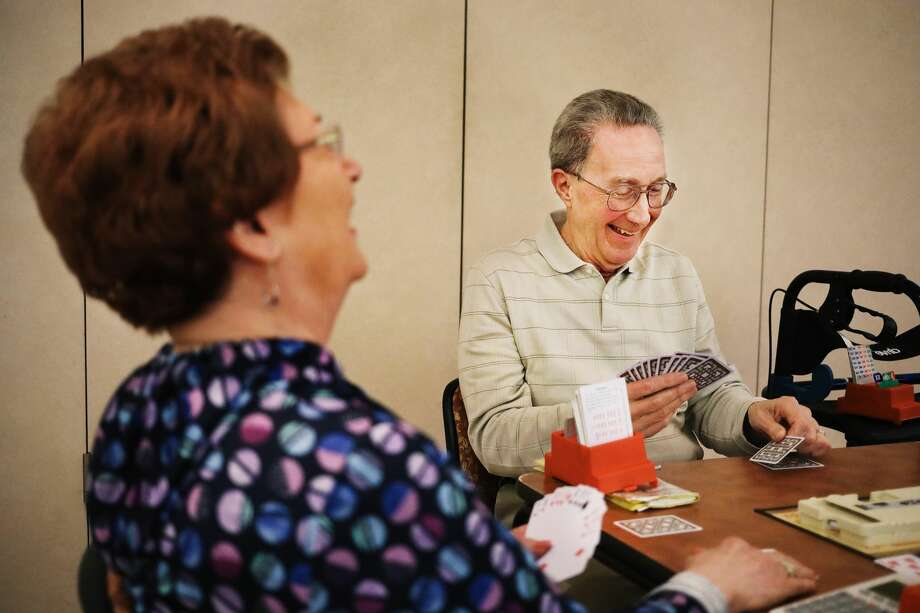 Mort Weldy of Saginaw, right, and Carmel Contardi of Bay City, left, laugh while playing bridge on Monday, Feb. 4, 2019 at the Greater Midland Community Center. (Katy Kildee/kkildee@mdn.net) Photo: (Katy Kildee/kkildee@mdn.net)