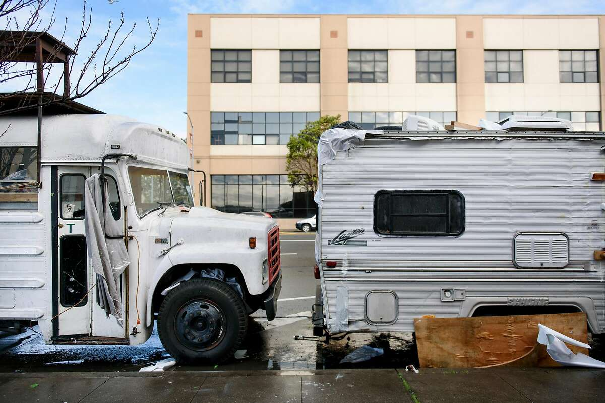 A school bus and a towing camper are seen lined up on Caesar Chavez Street in San Francisco, Calif., on Monday, February, 2019. San Francisco Supervisor Vallie Brown is proposing legislation designed to help people camping in their cars and RV's by giving them a designated and safe place to park.