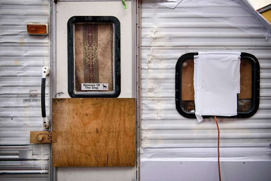 """A """"Beware of the Dog"""" sticker is seen in the window of an RV parked on Caesar Chavez Street in San Francisco. Photo: Michael Short / Special To The Chronicle"""