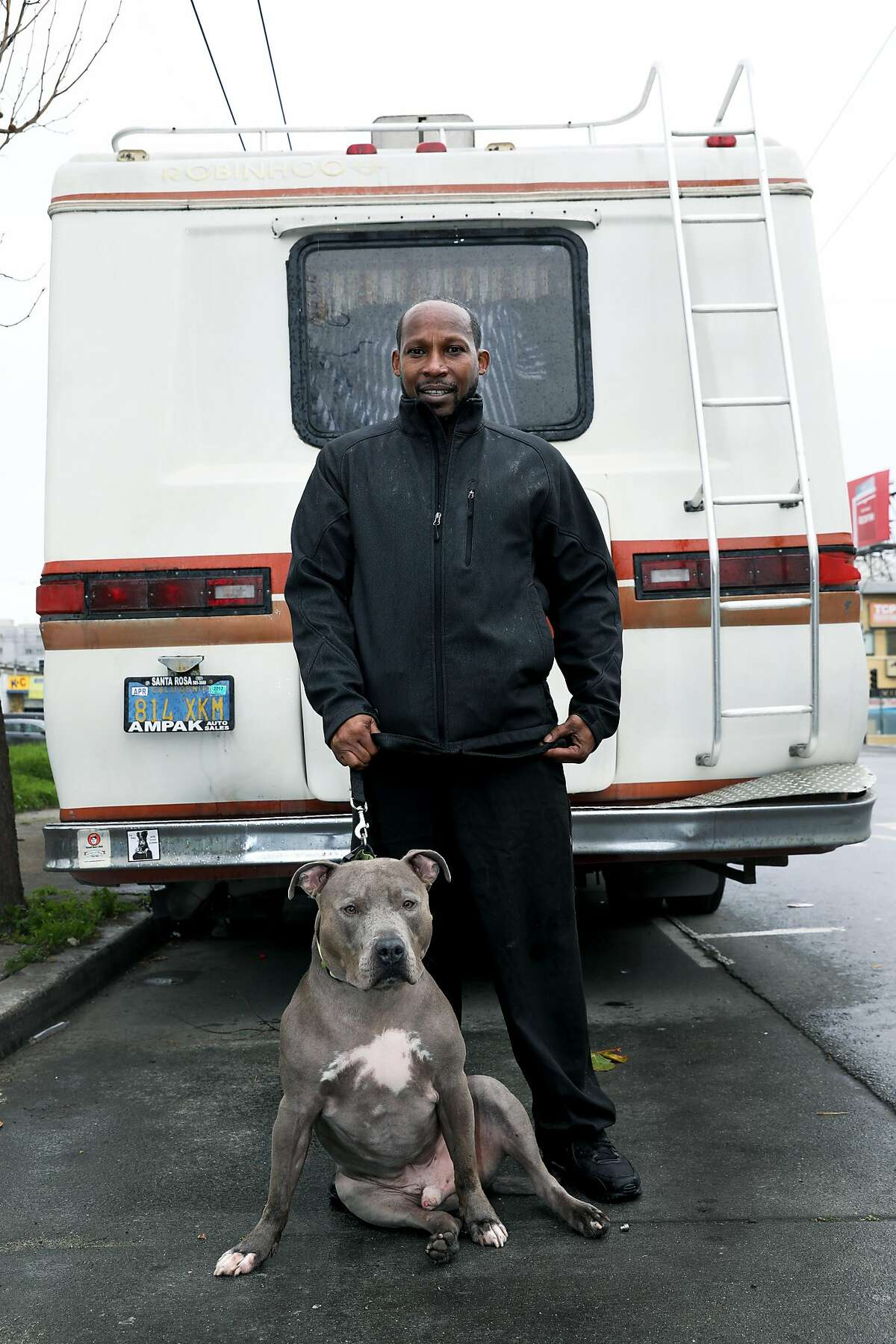 Ernest Owens, 54, stands with his dog Blue as they pose for a portrait near the corner of 5th and Harrison in San Francisco, Calif., on Friday, February 1, 2019. Owens and his wife, Lisa Owens (not pictured), live in their RV. City Supervisor Vallie Brown is proposing legislation designed to help people camping in their cars and RV campers.