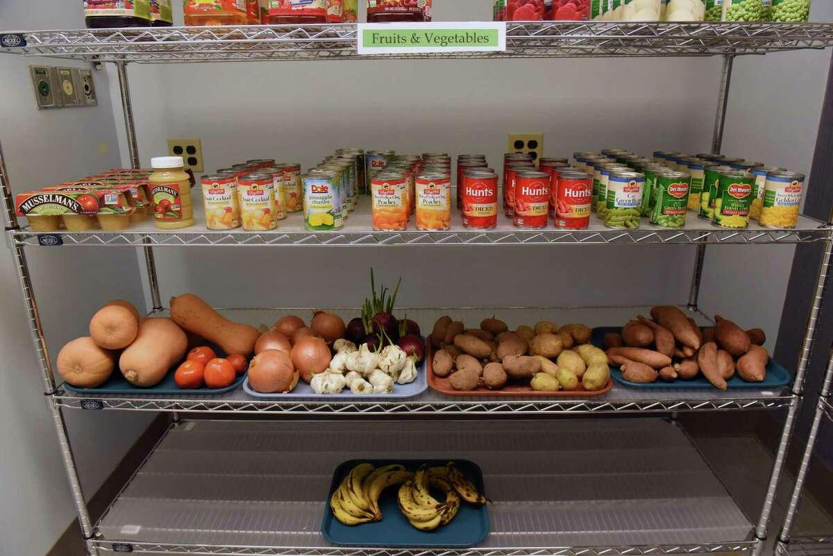 Food is organized on shelves at the Food Farmacy at the Ellis Medicine McClellan Street Health Center on Monday, Feb. 4, 2019 in Schenectady, N.Y. (Lori Van Buren/Times Union)