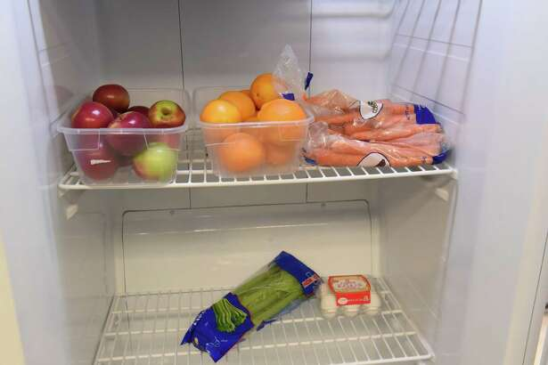 Food is seen in a refrigerator at the Food Farmacy at the Ellis Medicine McClellan Street Health Center on Monday, Feb. 4, 2019 in Schenectady, N.Y. (Lori Van Buren/Times Union)