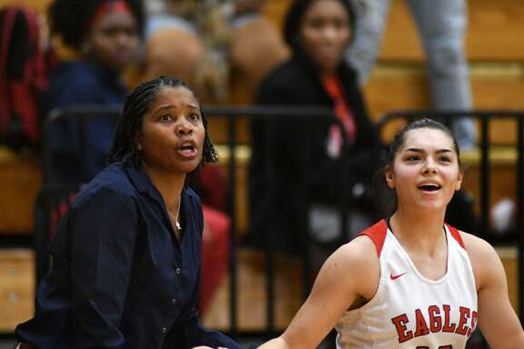 Atascocita Head Girls Basketball Coach Veronica Johnson, left, and Lady Eagles senior guard Brittney Stafford react to a made three pointer by Stafford against Dobie during their District 22-6A matchup at Atascocita High School on Jan. 25, 2019.