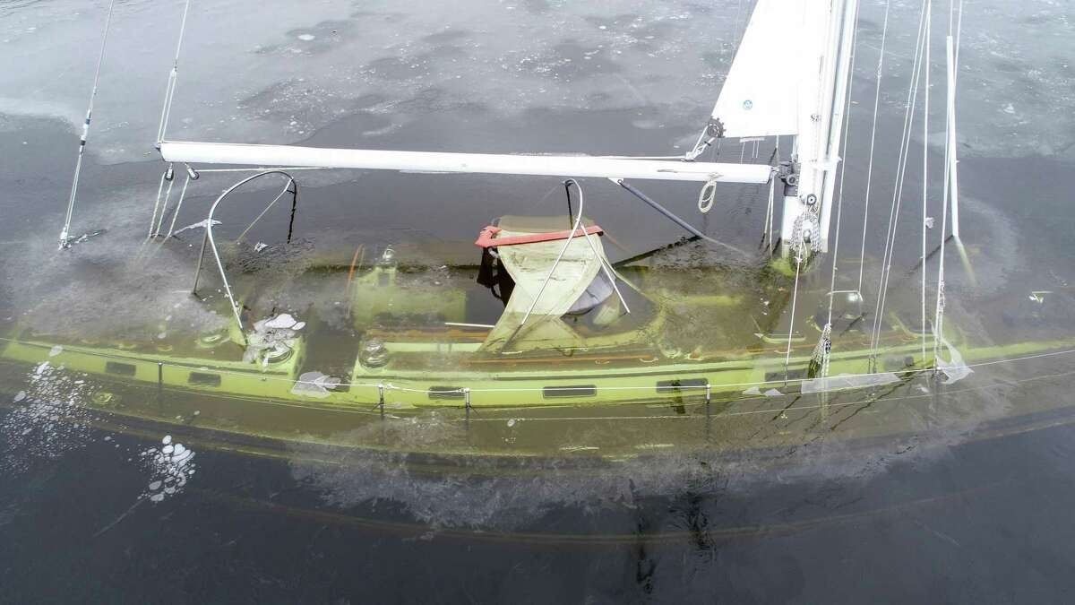 Lyme harbormaster sheds light on sinking of luxury yacht After a video of a sailing yacht sinking into the Icy Hamburg Cove went viral in January, people questioned how such a thing could happen. However, Lyme's harbormaster L. Thomas Reynolds said sinking situations are more common than people would expect. Reynolds speculated that the ships' bilge pump could have failed from an extreme temperature change. Fire departments, U.S. Coast Guard and the owner reportedly attempted to get the boat to a safe level before it sank. The Coast Guard considered the boat an environmental threat because of potential fuel leakage which could hurt the ecosystem and worked to expedite its removal as fast as possible. Read more: 53-foot sailboat sunk in Lyme's Hamburg Cove set to be raised