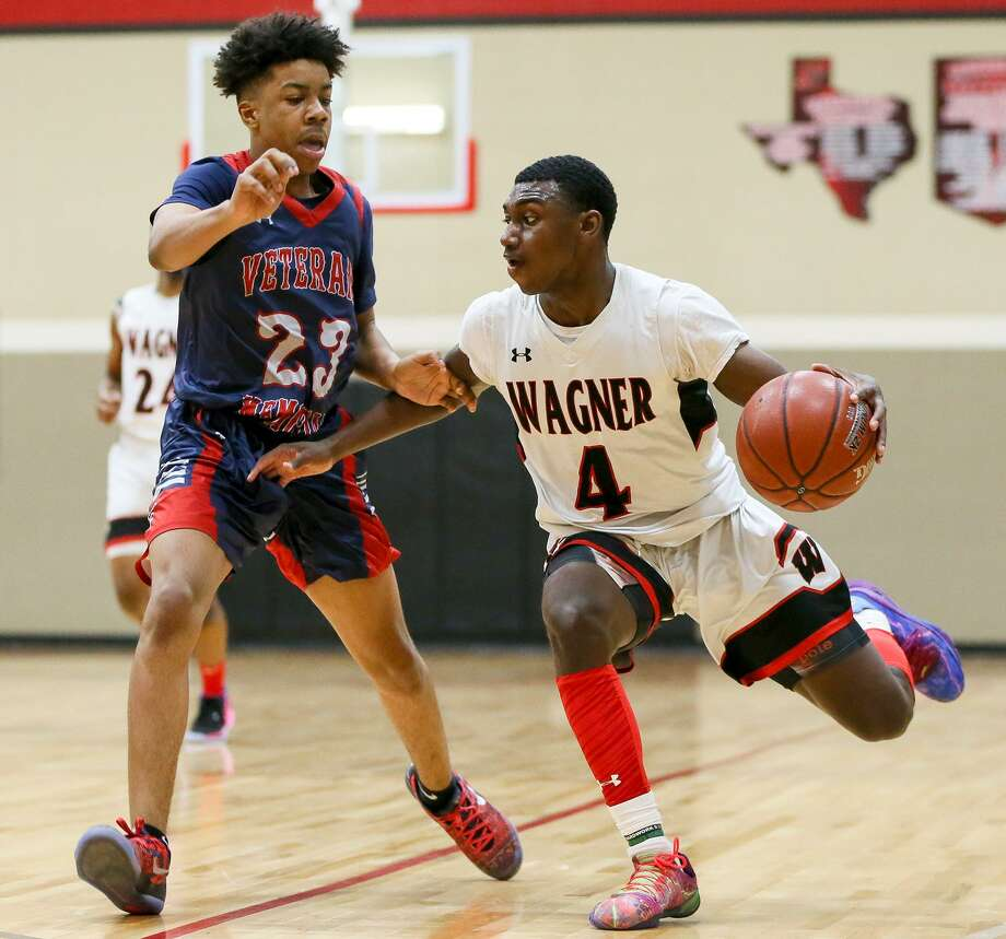 Wagner's Jalen Jackson drives past Veterans Memorial's Calvin Readdy during the first half of their District 26-5A boys basketball game at Wagner on Friday, Feb, 2019. Wagner beat Veterans Memorial 107-46. Photo: Marvin Pfeiffer / / Express-News 2019