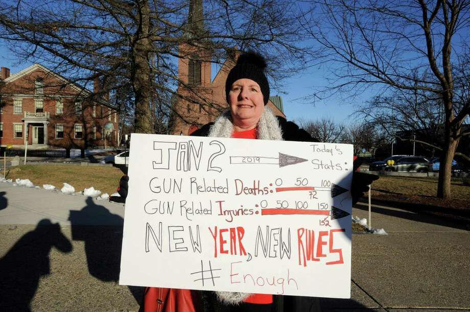 Heidi Solomon, shows her support for tighter gun laws, during the opening day of the House of Representatives at the New Hampshire State House on Jan. 2. A reader says he has a solution for eliminating crimes with guns. Photo: JOSEPH PREZIOSO /AFP /Getty Images / AFP or licensors