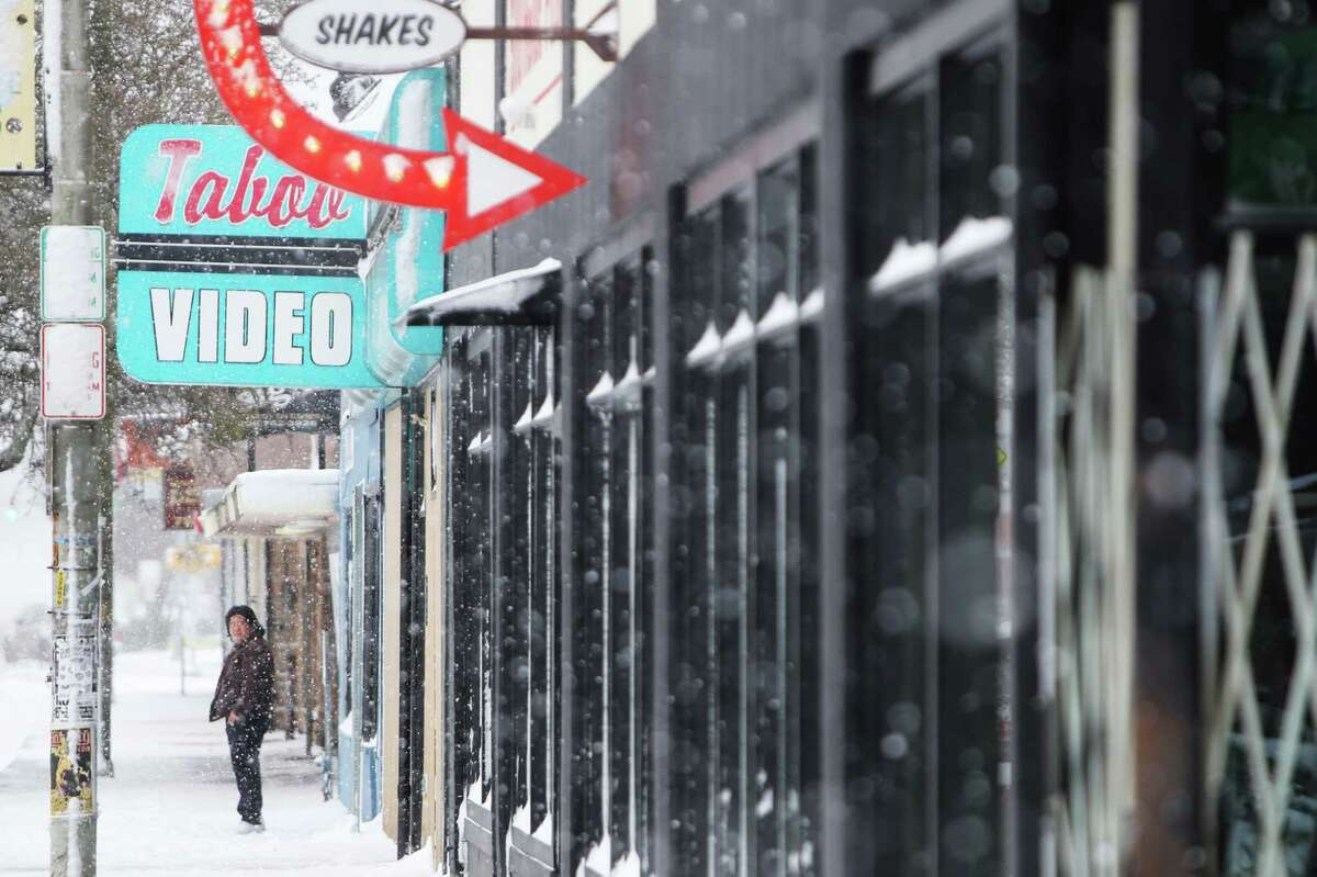 Many businesses are closed Monday morning in White Center as snow continues to build, Monday, Feb. 4, 2019.