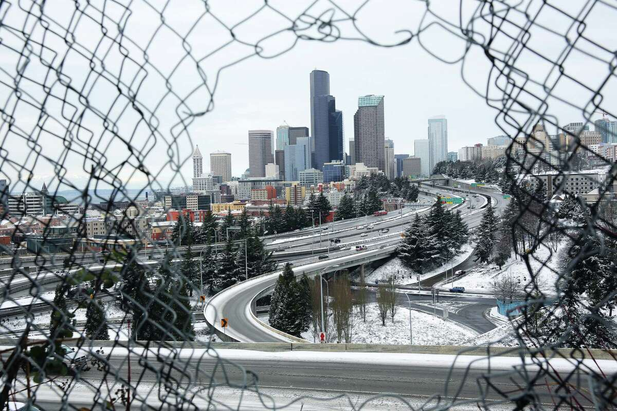 A layer of snow still coats downtown Seattle Monday afternoon, as seen from Dr. Jose Rizal Park, Feb. 4, 2019. Seattle saw several inches of snow accumulate over Sunday night and Monday morning.