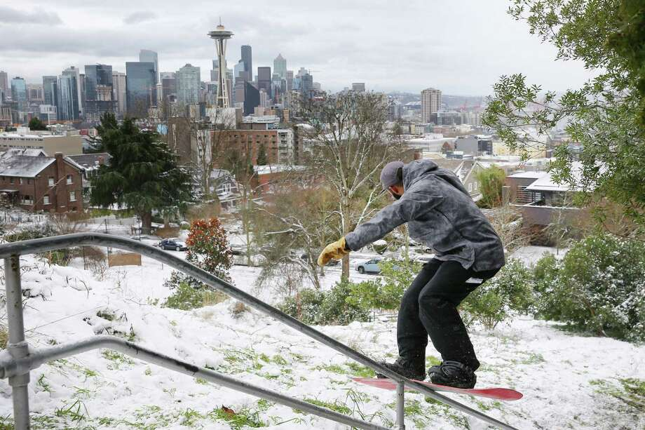 Professional snowboarder Max Dre Djenohan rides a rail at Kerry Park, Monday afternoon, after Seattle saw several inches of snow accumulate over Sunday night and Monday morning, Feb. 4, 2019. Photo: GENNA MARTIN, Seattlepi.com / SeattlePI