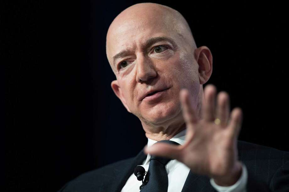 "In this file photo taken on September 19, 2018 Amazon and Blue Origin founder Jeff Bezos provides the keynote address at the Air Force Association's Annual Air, Space & Cyber Conference in Oxen Hill, Maryland. - Amazon on January 31, 2019 reported its profit in the past quarter surged on strong holiday retail sales and its soaring cloud computing business.The US tech giant said profit jumped 63 percent from a year ago to $3.0 billion in the fourth quarter as revenues increased 20 percent to $72.4 billion.The results reflected growth in Amazon's ever-expanding online retail operations as well as its large cloud computing division known as Amazon Web Services.Chief executive Jeff Bezos highlighted the role of Amazon's digital assistant Alexa as the company moves into infusing artificial intelligence into its smart speakers and other devices in a race for dominance in the ""internet of things"" market. Photo: JIM WATSON,  Contributor / AFP/Getty Images / AFP or licensors"