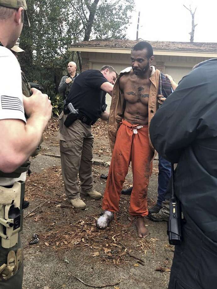 This Feb. 3, 2019 photo released by the Conroe Police Department shows Cedric Marks being captured after nine-hour manhunt that began when he escaped from a prisoner transport van in Conroe, Texas. Authorities say surveillance video helped police locate the MMA fighter facing murder charges after he escaped a prison van in Texas. Marks is suspected in the deaths of his ex-girlfriend and her friend. Their bodies were found buried in a shallow grave in Clearview, Oklahoma, on Jan. 15. (Conroe Police Department via AP) >>> See more details about why Marks was in Texas Photo: Associated Press