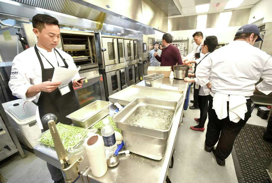 New Haven, Connecticut - Monday, February 4, 2019: Chinese chefs during a a visit Monday to the Yale Culinary Support Center in New Haven, prepare a meal in coordination with Yale University chefs for approximately 250 Yale University students and Yale V.I.P.'s  that is 85% plant-based version of a traditional Chinese New Year menu. The cooking and dinner is the start of a 2-week long Northeast sustainability-focused food tour by the 7 Chinese chefs and other Chinese food industry leaders, the Food Forward Forum. Besides Yale, the group will also visit the University of Connecticut, the University of Massachusetts at Amherst and the University of Hartford. Photo: Peter Hvizdak, Hearst Connecticut Media / New Haven Register