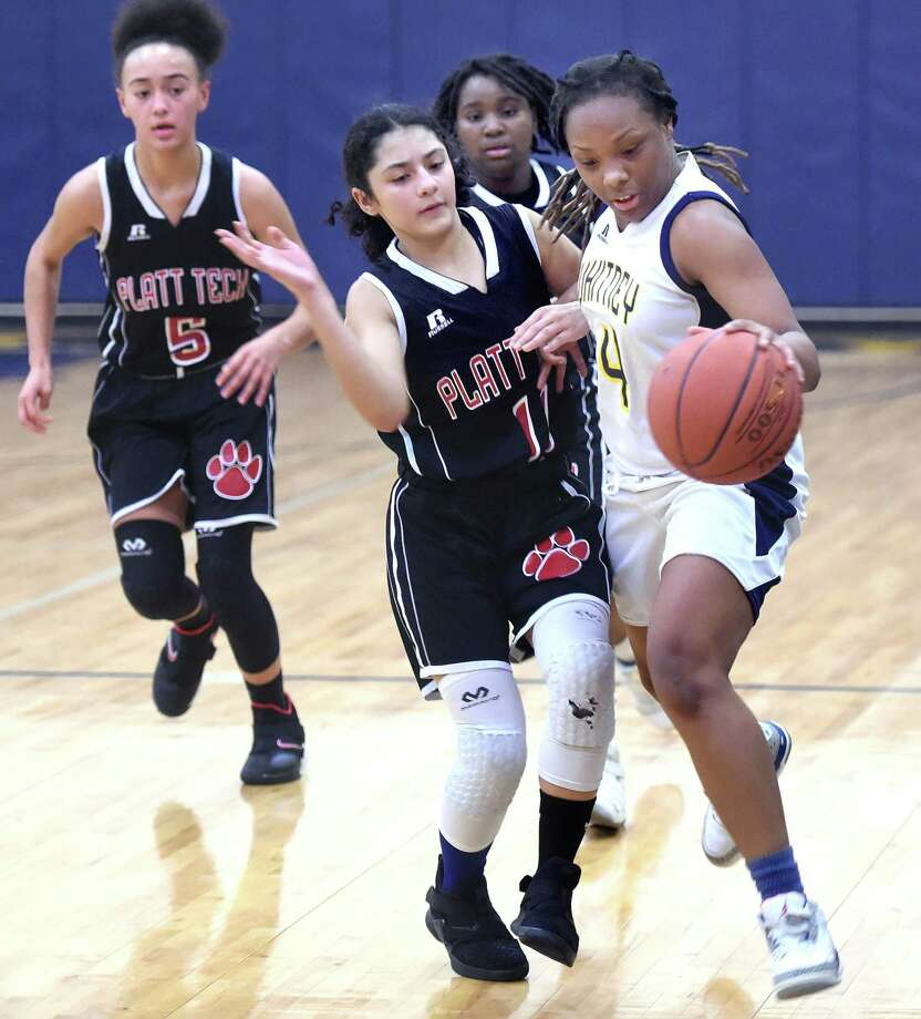 Platt Tech's Angie Tocci, center, pressures Whitney Tech's Gianni Atkinson on Monday in Hamden. Photo: Arnold Gold / Hearst Connecticut Media / New Haven Register