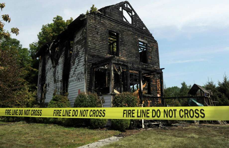 The Locust Road home that collapsed early Friday morning, August 10, 2018, after a fire broke out overnight in Greenwich, Conn. The Greenwich Fire Department responded to a fire at 15 Locust Road around midnight and said the two-and-a-half story home was completely aflame by the time units arrived. Photo: Erik Trautmann / Hearst Connecticut Media / Norwalk Hour