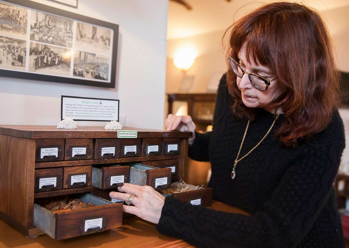 Mandy Aftel organizes physical products that create a variety of perfumes and scents displayed at the Aftel Archive of Curious Scents in Berkeley, Calif. Tuesday, Jan. 29, 2019.