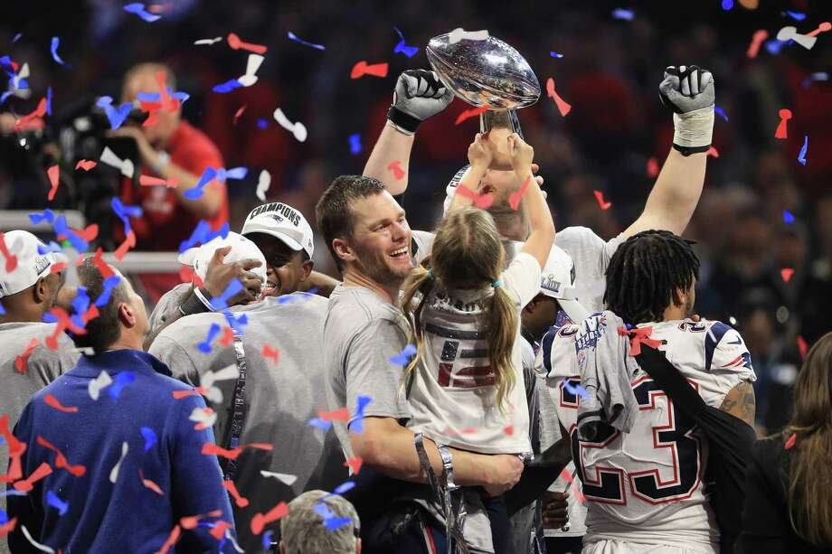 Tom Brady, No. 12, of the New England Patriots celebrates with daughter Vivian who raises the Vince Lombardi Trophy after Super Bowl LIII at Mercedes-Benz Stadium on February 3, 2019 in Atlanta, Georgia. The New England Patriots defeat the Los Angeles Rams 13-3. ( Photo: Mike Ehrmann /Getty Images / 2019 Getty Images