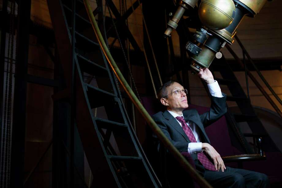 Avi Loeb poses in the observatory near his office in Cambridge, Mass. His theory about an alien spaceship has made the rounds in the media and caused controversy in the academic community. Photo: Photo For The Washington Post By Adam Glanzman / For The Washington Post