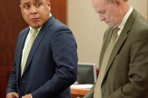 Marco Carrizales, a former Harris County Sheriff's deputy, left, and his defense attorney Brock Akers, right, in the Harris County Criminal Court at his trial Monday, Feb. 4, 2019, in Houston. Carrizales is accused of beating a driver so brutally that he broke the man's eye socket and caused serious bodily injury. Sgt. Marco Carrizales was working an extra job in uniform in October 2015, directing traffic for a refinery, when Ismael Garza apparently ran a stop sign, causing Carrizales to give chase.