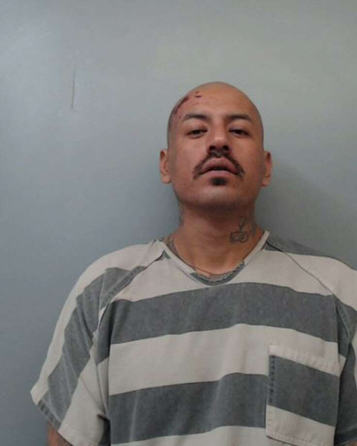 Juan Carlos Moreno, 42, was charged with aggravated assault on a public servant, deadly conduct, evading arrest with a vehicle, resisting arrest and unlawful carrying of a weapon. Photo: Webb County Sheriff's Office /Courtesy Photo