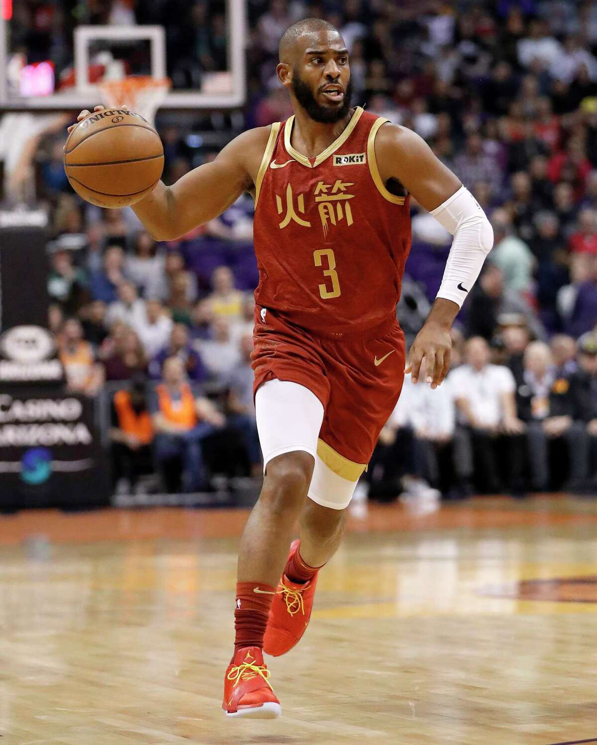 Houston Rockets guard Chris Paul (3) moves the ball up court against the Phoenix Suns during the first half of an NBA basketball game, Monday, Feb. 4, 2019, in Phoenix. (AP Photo/Matt York)