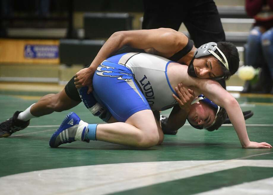 Norwalk's Cesar Rivera, top, defeats Fairfield Ludlowe's Sean Zimmerman in the 138 pound match during a wrestling meet between the two FCIAC schools at Norwalk High School in Norwalk, Conn. on Monday, February 4, 2019. Photo: Brian A. Pounds / Hearst Connecticut Media / Connecticut Post