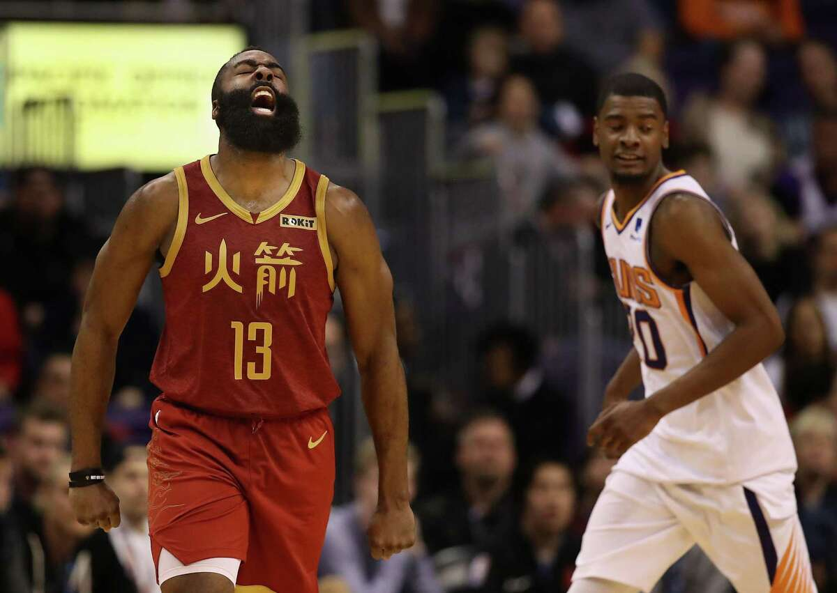 PHOENIX, ARIZONA - FEBRUARY 04: James Harden #13 of the Houston Rockets reacts after hitting a three-point shot ahead of Josh Jackson #20 of the Phoenix Suns during the second half of the NBA game at Talking Stick Resort Arena on February 04, 2019 in Phoenix, Arizona. The Rockets defeated the Suns 118-110.
