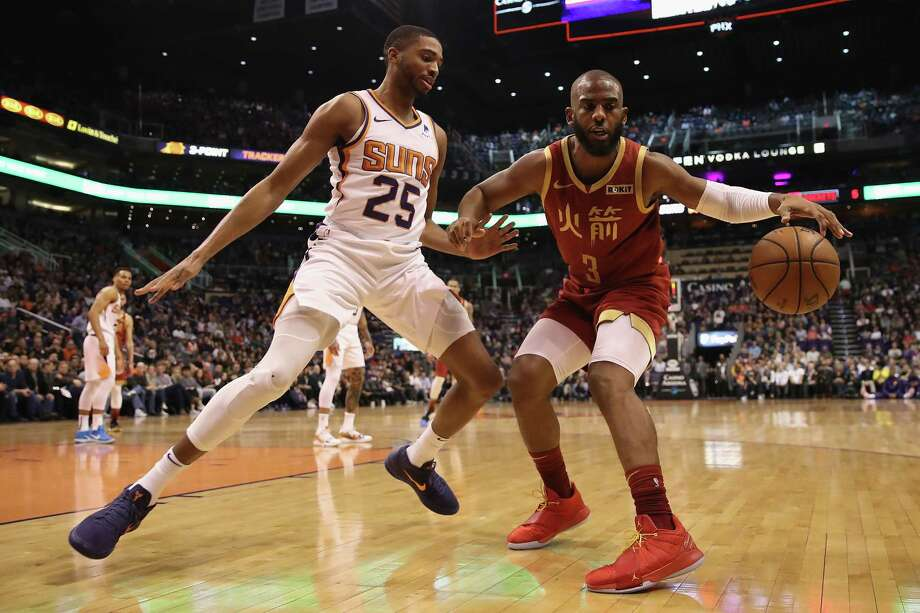 PHOTOS: 2018-19 Rockets game-by-game PHOENIX, ARIZONA - FEBRUARY 04:  Chris Paul #3 of the Houston Rockets handles the ball under pressure from Mikal Bridges #25 of the Phoenix Suns during the first half of the NBA game at Talking Stick Resort Arena on February 04, 2019 in Phoenix, Arizona. >>>See how the Rockets have fared in each game this season ... Photo: Christian Petersen, Getty Images / 2019 Getty Images
