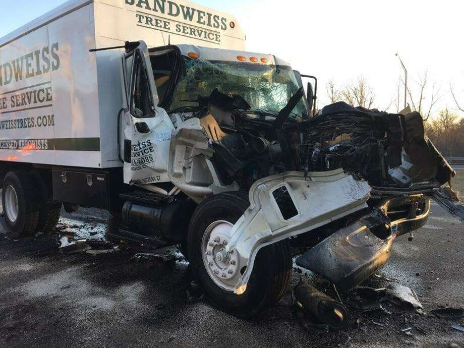 Four people were taken to Yale-New Haven Hospital after a multi-vehicle crash on the Mount Carmel Connector on Monday, Feb. 4, 2019. A photo tweeted by the Hamden Fire Department showed a truck owned by Sandweiss Tree Service of Hamden showed extensive front-end damage. Photo: Hamden Fire Department Photo