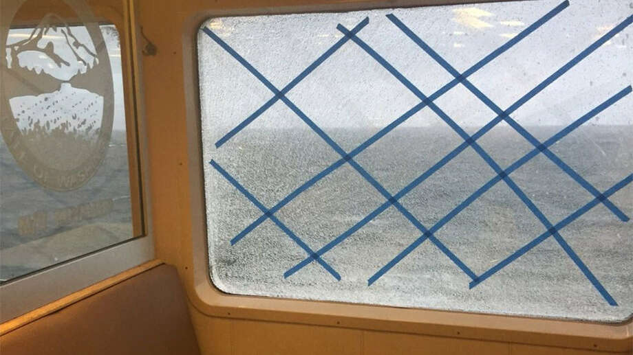 A window is taped up on the ferry Puyallup after it was shattered by the impact of pounding waves on the Edmonds-Kingston run. (Photo credit: Wash. State Ferries)  Keep clicking to see historical photos of Washington's ferries... Photo: Washington State Ferries