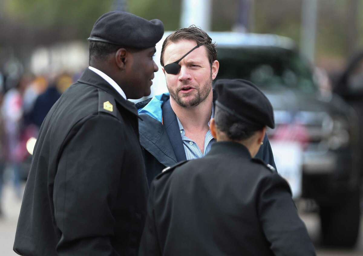 U.S. Representative for Texas's 2nd congressional district Dan Crenshaw talks to ROTC leaders before the 13th Annual MLK Youth Parade Saturday, Jan. 19, 2019, in Houston.