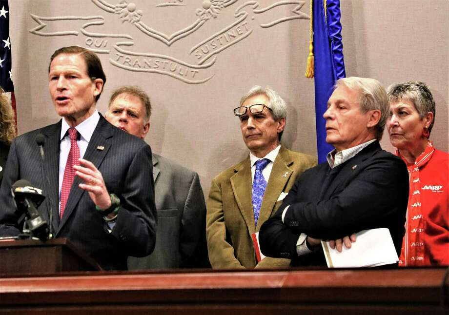 Former Sen. Len Suzio, R-Meriden, second from right, in a den of liberals at a press conference calling for elimination of the residential third party electric supplier market. From left, U.S. Sen. Richard Blumenthal; Tom Swan, director of the Connecticut Citizen Action Group; Rep. Peter Tercyak, D-New Britain; Suzio; and Debra St. Germain, a Connecticut AARP volunteer. Photo: Mike Humes / Courtesy Of AARP