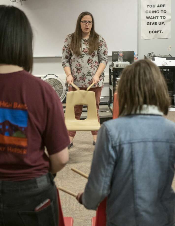 Alamo Junior High band instructor Stacy McBurney works with students 02/05/19. McBurney teaches band as well as life skills music appreciation. Tim Fischer/Reporter-Telegram Photo: Tim Fischer/Midland Reporter-Telegram