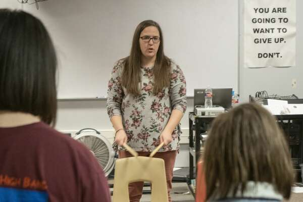 Alamo Junior High band instructor Stacy McBurney works with students 02/05/19. McBurney teaches band as well as life skills music appreciation. Tim Fischer/Reporter-Telegram