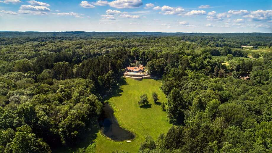 "A view of ""Hilltop Country Estate,"" from an airplane, not a drone, shows how private its 24-acre setting is. Photo: M3Media Productions LLC / ©Copyright 2017-2018 M3Media Productions LLC"